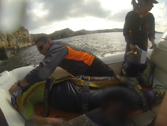 Graham Sansone being strapped into the rescue dinghy